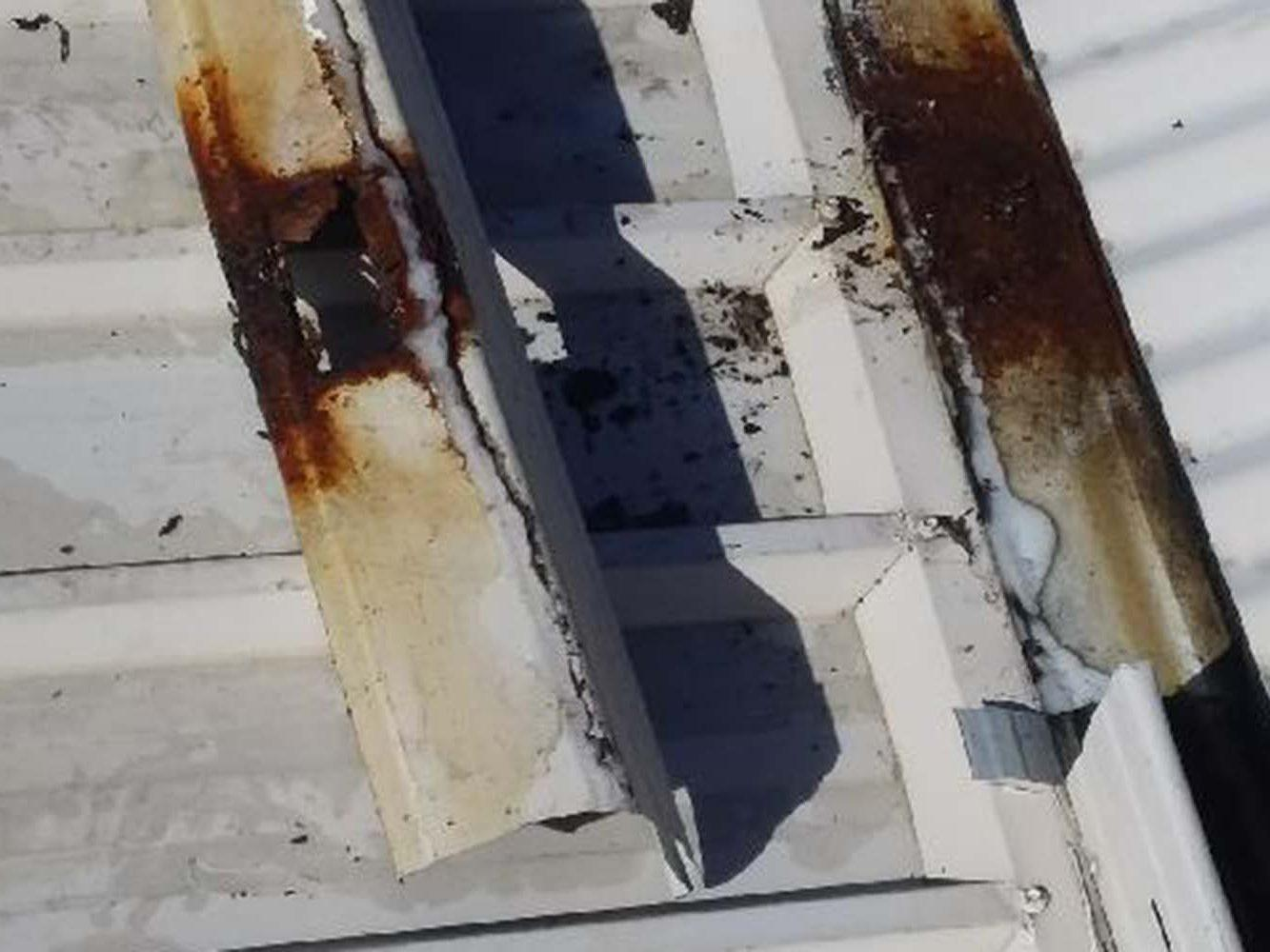 rusted roofing iron - plumbing repair Buderim